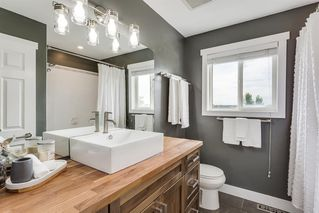 Photo 18: 31 SILVER CREEK Boulevard NW: Airdrie Detached for sale : MLS®# A1015467