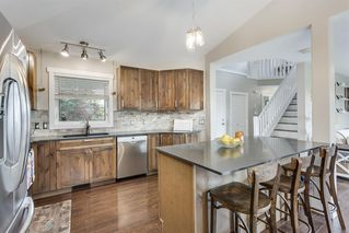 Photo 7: 31 SILVER CREEK Boulevard NW: Airdrie Detached for sale : MLS®# A1015467