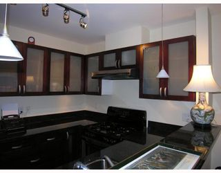"""Photo 5: 402 1586 W 11TH Avenue in Vancouver: Fairview VW Condo for sale in """"TORREY PINES"""" (Vancouver West)  : MLS®# V672396"""