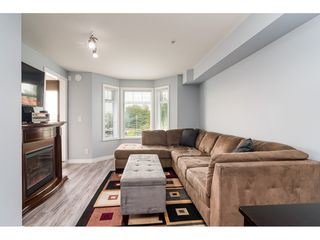 """Photo 4: 334 5660 201A Street in Langley: Langley City Condo for sale in """"Paddington Station"""" : MLS®# R2498914"""