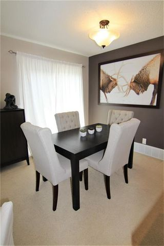 Photo 7: 127 MILLCREST Way SW in Calgary: Millrise Detached for sale : MLS®# C4306441