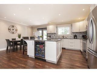 """Photo 12: 3952 205B Street in Langley: Brookswood Langley House for sale in """"Brookswood"""" : MLS®# R2486074"""