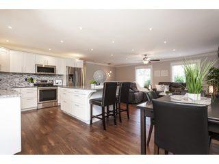 """Photo 10: 3952 205B Street in Langley: Brookswood Langley House for sale in """"Brookswood"""" : MLS®# R2486074"""