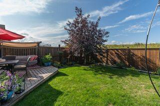 Photo 12: 168 ASCOT CR SW in Calgary: Aspen Woods House for sale : MLS®# C4268023
