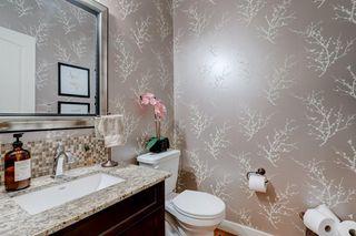 Photo 40: 168 ASCOT CR SW in Calgary: Aspen Woods House for sale : MLS®# C4268023