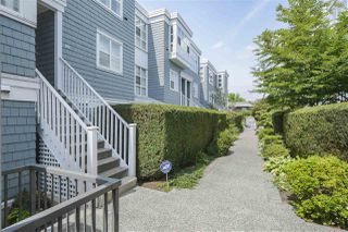 "Photo 1: 201 657 W 7TH Avenue in Vancouver: Fairview VW Townhouse for sale in ""THE IVYS"" (Vancouver West)  : MLS®# R2393485"