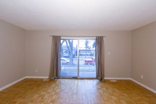 Photo 3: 11215/11217 93 Street in Edmonton: Zone 05 House Duplex for sale : MLS®# E4176104