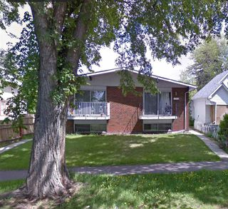 Photo 1: 11215/11217 93 Street in Edmonton: Zone 05 House Duplex for sale : MLS®# E4176104