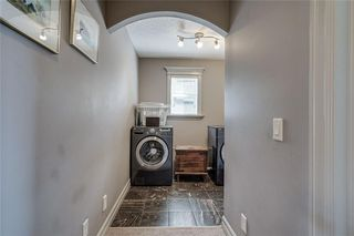 Photo 37: 977 COOPERS Drive SW: Airdrie Detached for sale : MLS®# C4303324