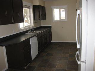 Photo 2: 8755 92A Avenue in Edmonton: Zone 18 House for sale : MLS®# E4221392