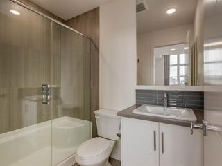 Photo 18: 55 Walden Path SE in Calgary: Walden Row/Townhouse for sale : MLS®# A1016717