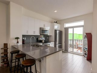 Photo 3: 55 Walden Path SE in Calgary: Walden Row/Townhouse for sale : MLS®# A1016717