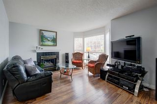 Photo 4: 100 Somerside Manor SW in Calgary: Somerset Detached for sale : MLS®# A1038444