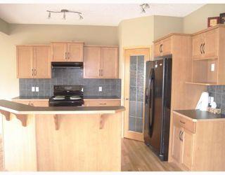 Photo 4: 1844 NEW BRIGHTON Drive SE in CALGARY: New Brighton Residential Detached Single Family for sale (Calgary)  : MLS®# C3327514