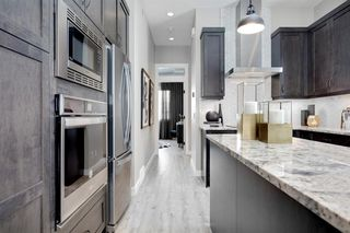Photo 13: 230 Lucas Parade NW in Calgary: Livingston Detached for sale : MLS®# A1057760
