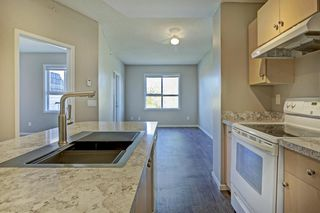 Photo 2: 4104 73 Erin Woods Court SE in Calgary: Erin Woods Apartment for sale : MLS®# A1042999