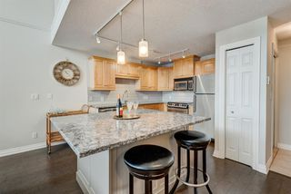 Photo 1: 408 630 10 Street NW in Calgary: Sunnyside Apartment for sale : MLS®# A1027262