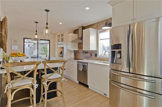 Photo 11: 84 COACH SIDE TC SW in Calgary: Coach Hill House for sale : MLS®# C4274521