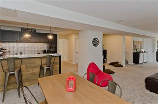 Photo 32: 84 COACH SIDE TC SW in Calgary: Coach Hill House for sale : MLS®# C4274521
