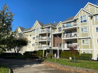 """Photo 1: 307 20189 54 Avenue in Langley: Langley City Condo for sale in """"CATALINA GARDENS"""" : MLS®# R2512331"""