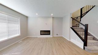 Photo 2: 7885 170A Avenue in Edmonton: Zone 28 House Half Duplex for sale : MLS®# E4169610