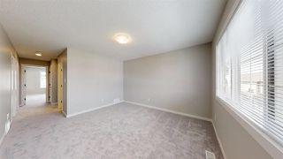 Photo 16: 7885 170A Avenue in Edmonton: Zone 28 House Half Duplex for sale : MLS®# E4169610