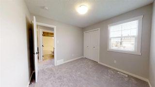 Photo 20: 7885 170A Avenue in Edmonton: Zone 28 House Half Duplex for sale : MLS®# E4169610