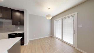 Photo 7: 7885 170A Avenue in Edmonton: Zone 28 House Half Duplex for sale : MLS®# E4169610