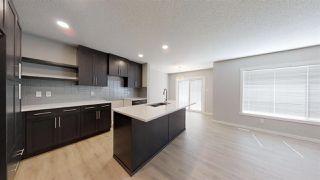 Photo 4: 7885 170A Avenue in Edmonton: Zone 28 House Half Duplex for sale : MLS®# E4169610