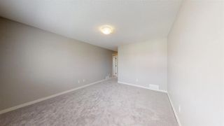 Photo 17: 7885 170A Avenue in Edmonton: Zone 28 House Half Duplex for sale : MLS®# E4169610