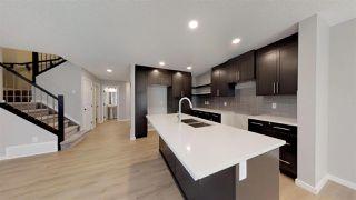 Photo 3: 7885 170A Avenue in Edmonton: Zone 28 House Half Duplex for sale : MLS®# E4169610