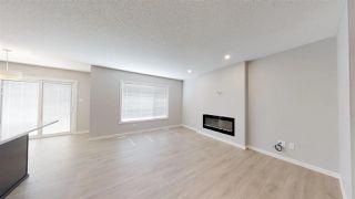 Photo 9: 7885 170A Avenue in Edmonton: Zone 28 House Half Duplex for sale : MLS®# E4169610