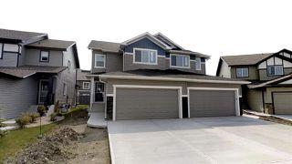 Photo 1: 7885 170A Avenue in Edmonton: Zone 28 House Half Duplex for sale : MLS®# E4169610
