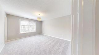 Photo 25: 7885 170A Avenue in Edmonton: Zone 28 House Half Duplex for sale : MLS®# E4169610