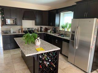 Photo 4: 12118 79 Street in Edmonton: Zone 05 House Half Duplex for sale : MLS®# E4179116