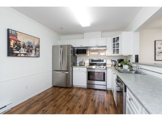 "Photo 3: 118 15210 GUILDFORD Drive in Surrey: Guildford Condo for sale in ""THE BOULEVARD CLUB"" (North Surrey)  : MLS®# R2478167"