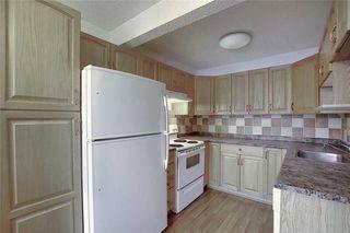 Photo 6: 1 195 MANORA Place NE in Calgary: Marlborough Park Row/Townhouse for sale : MLS®# C4304842