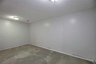 Photo 21: 1 195 MANORA Place NE in Calgary: Marlborough Park Row/Townhouse for sale : MLS®# C4304842