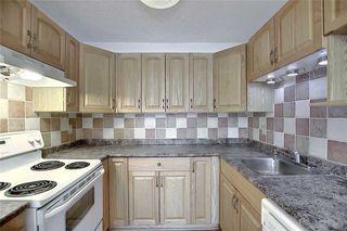 Photo 8: 1 195 MANORA Place NE in Calgary: Marlborough Park Row/Townhouse for sale : MLS®# C4304842