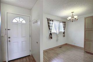 Photo 9: 1 195 MANORA Place NE in Calgary: Marlborough Park Row/Townhouse for sale : MLS®# C4304842