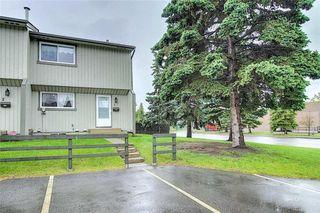 Photo 2: 1 195 MANORA Place NE in Calgary: Marlborough Park Row/Townhouse for sale : MLS®# C4304842