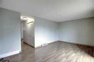 Photo 11: 1 195 MANORA Place NE in Calgary: Marlborough Park Row/Townhouse for sale : MLS®# C4304842
