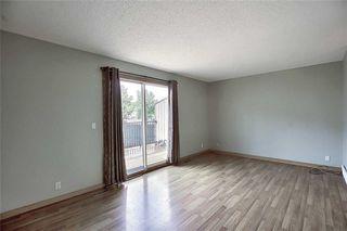 Photo 12: 1 195 MANORA Place NE in Calgary: Marlborough Park Row/Townhouse for sale : MLS®# C4304842