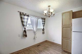 Photo 4: 1 195 MANORA Place NE in Calgary: Marlborough Park Row/Townhouse for sale : MLS®# C4304842
