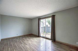 Photo 10: 1 195 MANORA Place NE in Calgary: Marlborough Park Row/Townhouse for sale : MLS®# C4304842