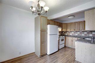 Photo 3: 1 195 MANORA Place NE in Calgary: Marlborough Park Row/Townhouse for sale : MLS®# C4304842