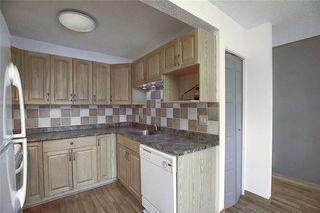 Photo 7: 1 195 MANORA Place NE in Calgary: Marlborough Park Row/Townhouse for sale : MLS®# C4304842