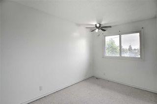 Photo 17: 1 195 MANORA Place NE in Calgary: Marlborough Park Row/Townhouse for sale : MLS®# C4304842