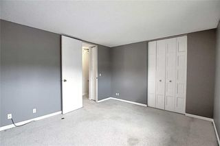 Photo 15: 1 195 MANORA Place NE in Calgary: Marlborough Park Row/Townhouse for sale : MLS®# C4304842