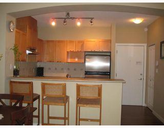 """Photo 4: 209 2969 WHISPER Way in Coquitlam: Westwood Plateau Condo for sale in """"SUMMERLIN AT SILVER SPRINGS"""" : MLS®# V676832"""